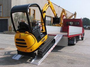 Loading a digger using plant ramps