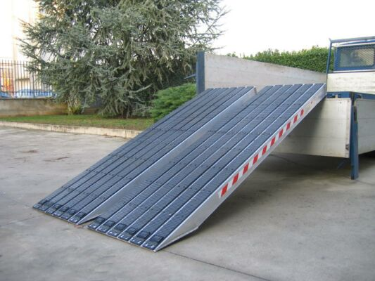 Pair of rubber coated loading ramps on vehicle