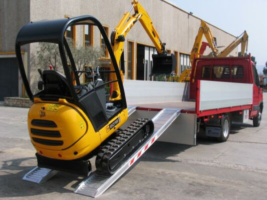 Rubber tracked vehicle driving up ramps