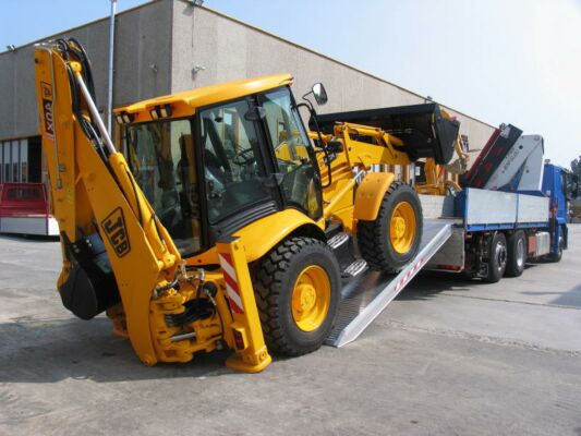 Digger loading on to tipper truck